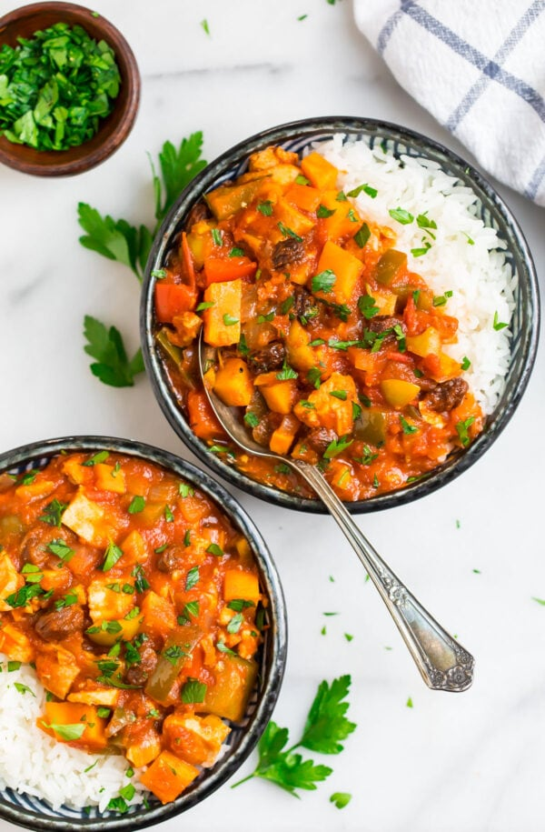 two bowls of chicken and vegetable stew over rice