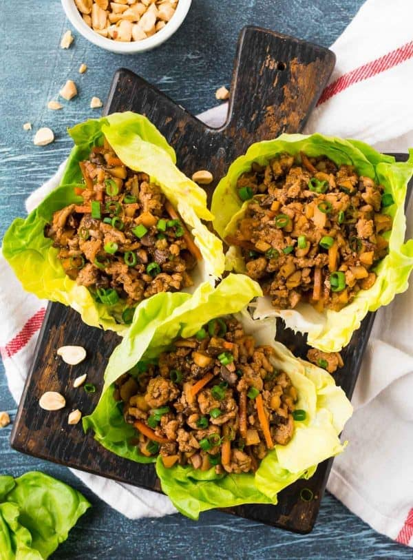 Healthy Asian lettuce wraps with ground chicken or ground turkey, green onions, and fresh veggies