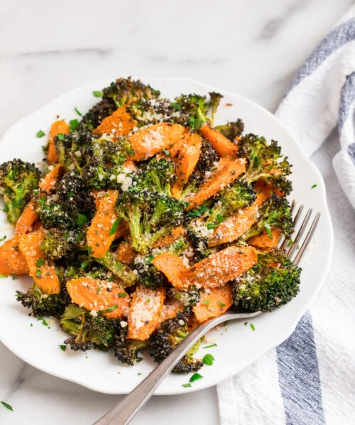 Roasted broccoli and carrots on a white plate