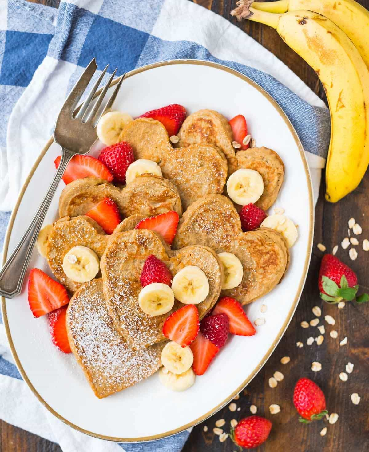 A special, healthy breakfast recipe served on a white platter with fresh fruit