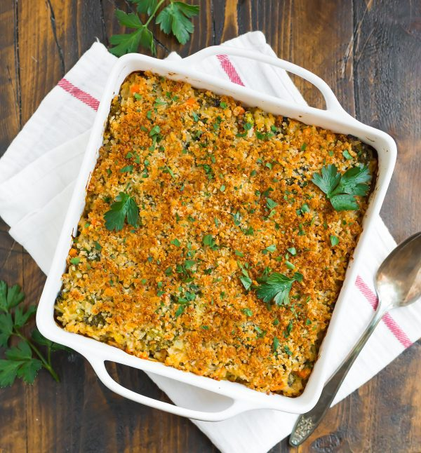 Healthy broccoli rice casserole in a baking dish on a dish towel