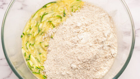 Dry and wet ingredients in a glass mixing bowl