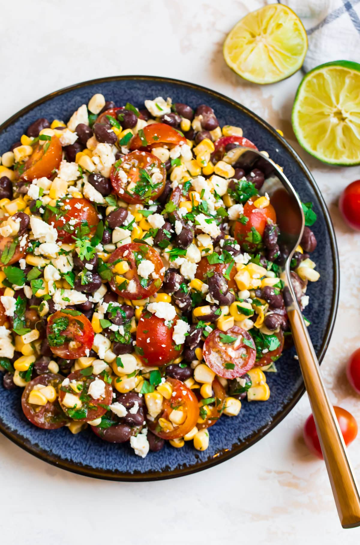 A plate of black bean and corn salad with feta