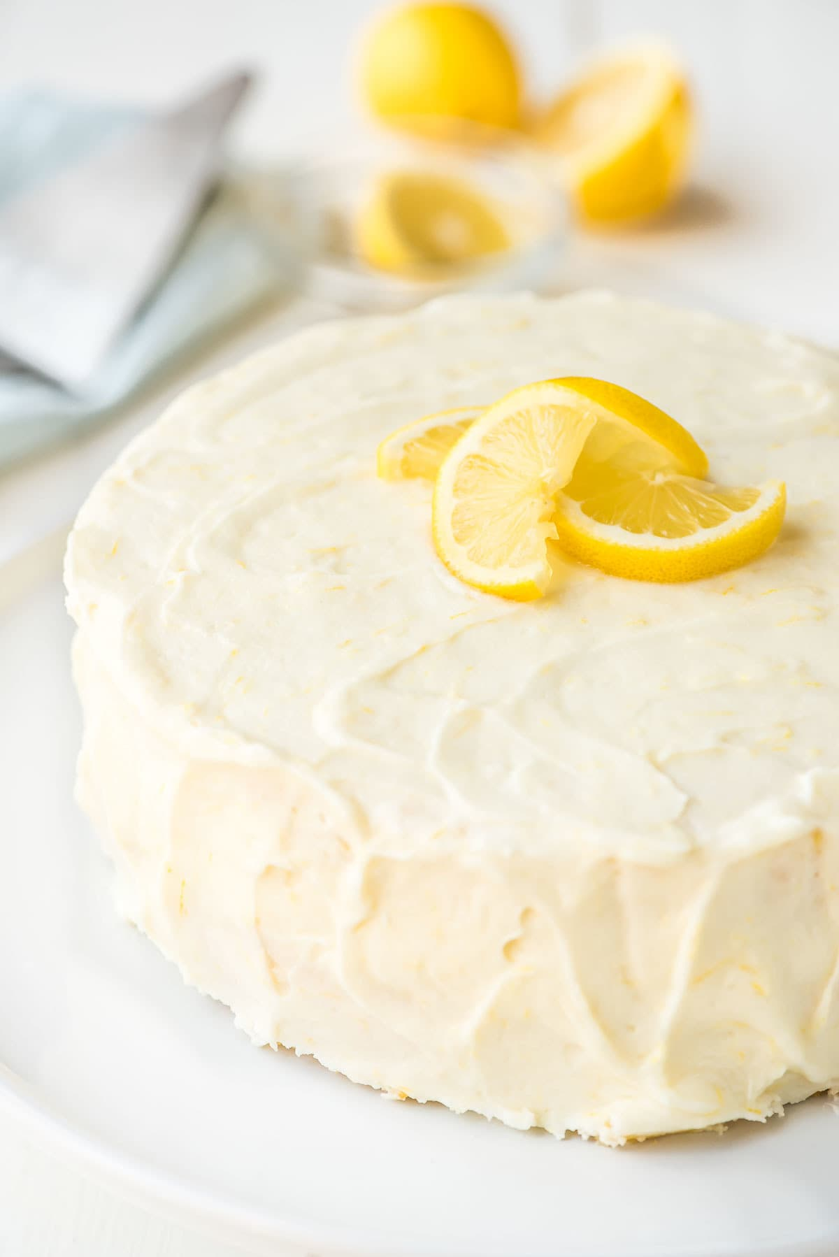Beautifully frosted lemon cake with lemon cream cheese frosting