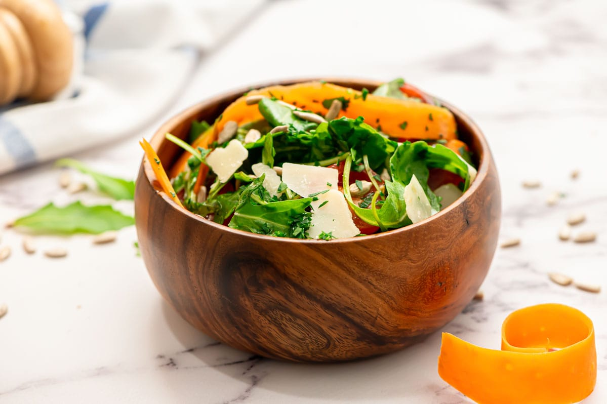 Easy arugula salad with Parmesan in a bowl