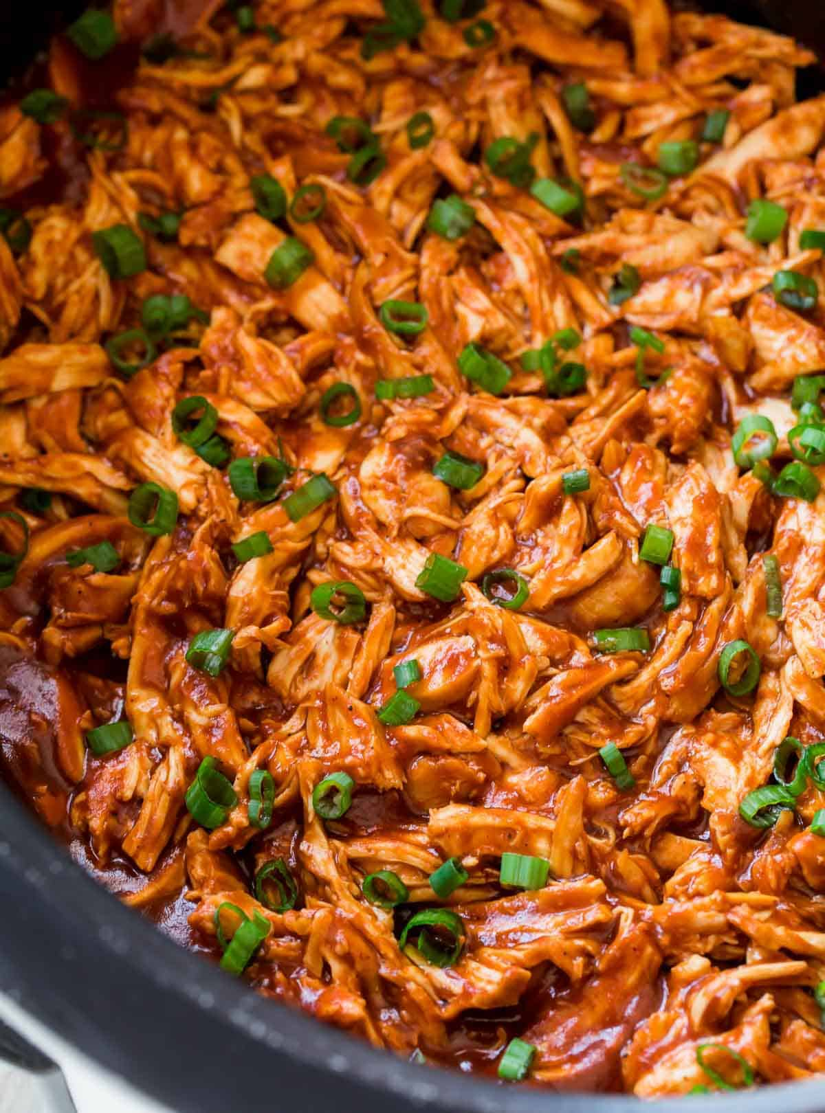 Shredded chicken in a slow cooker with sauce