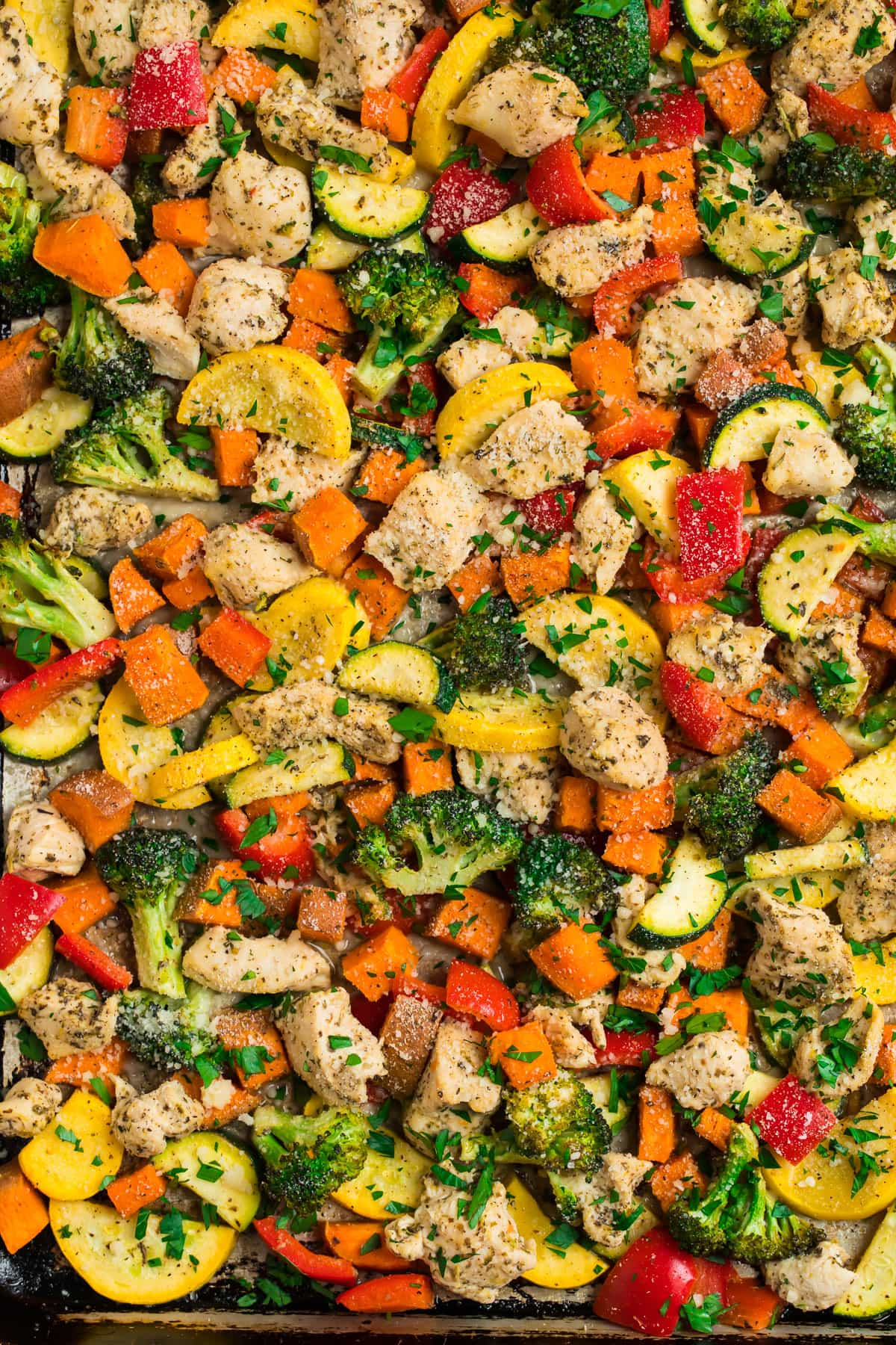 Chicken and vegetables on a baking sheet