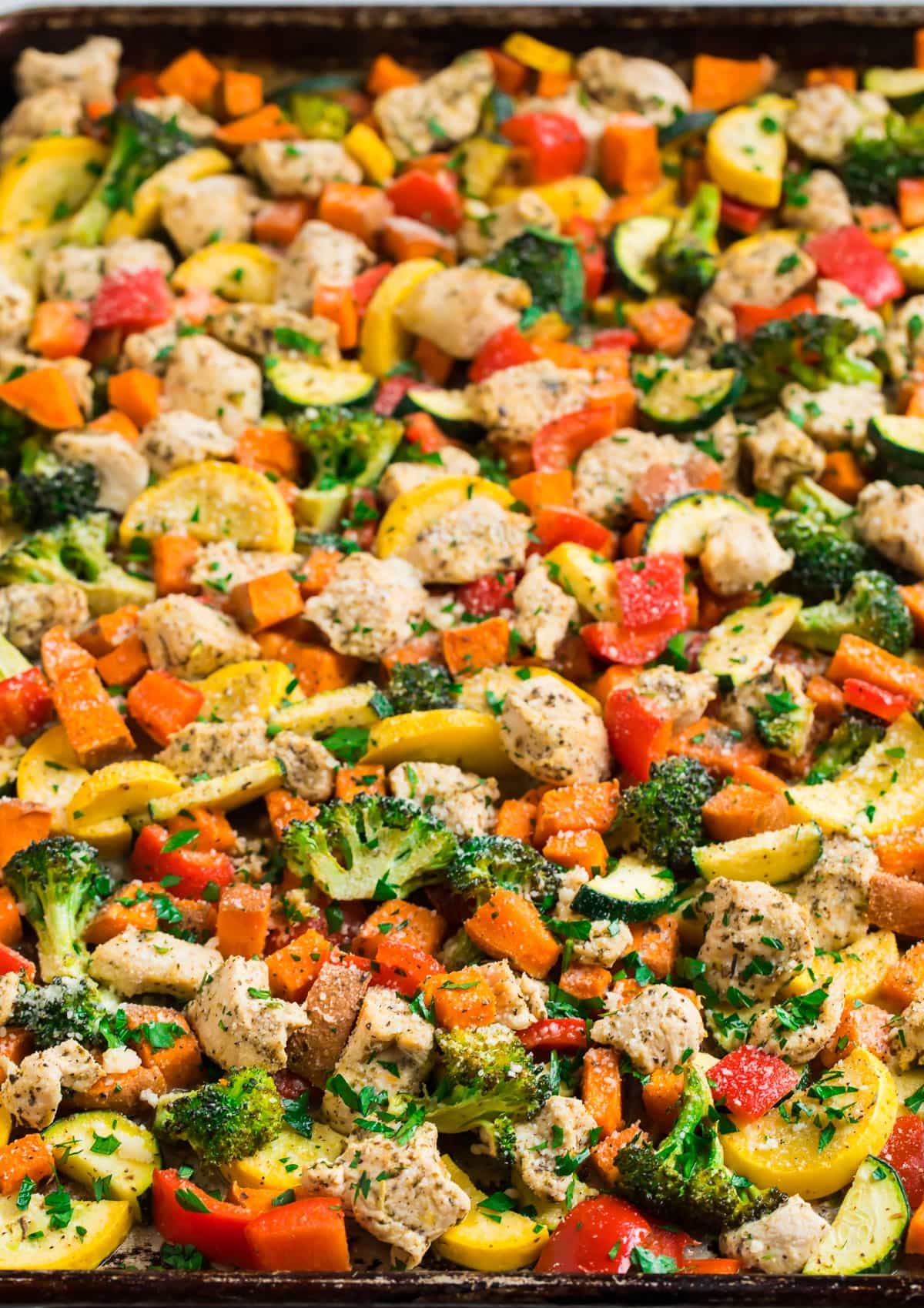 A sheet pan full of vegetables and chicken