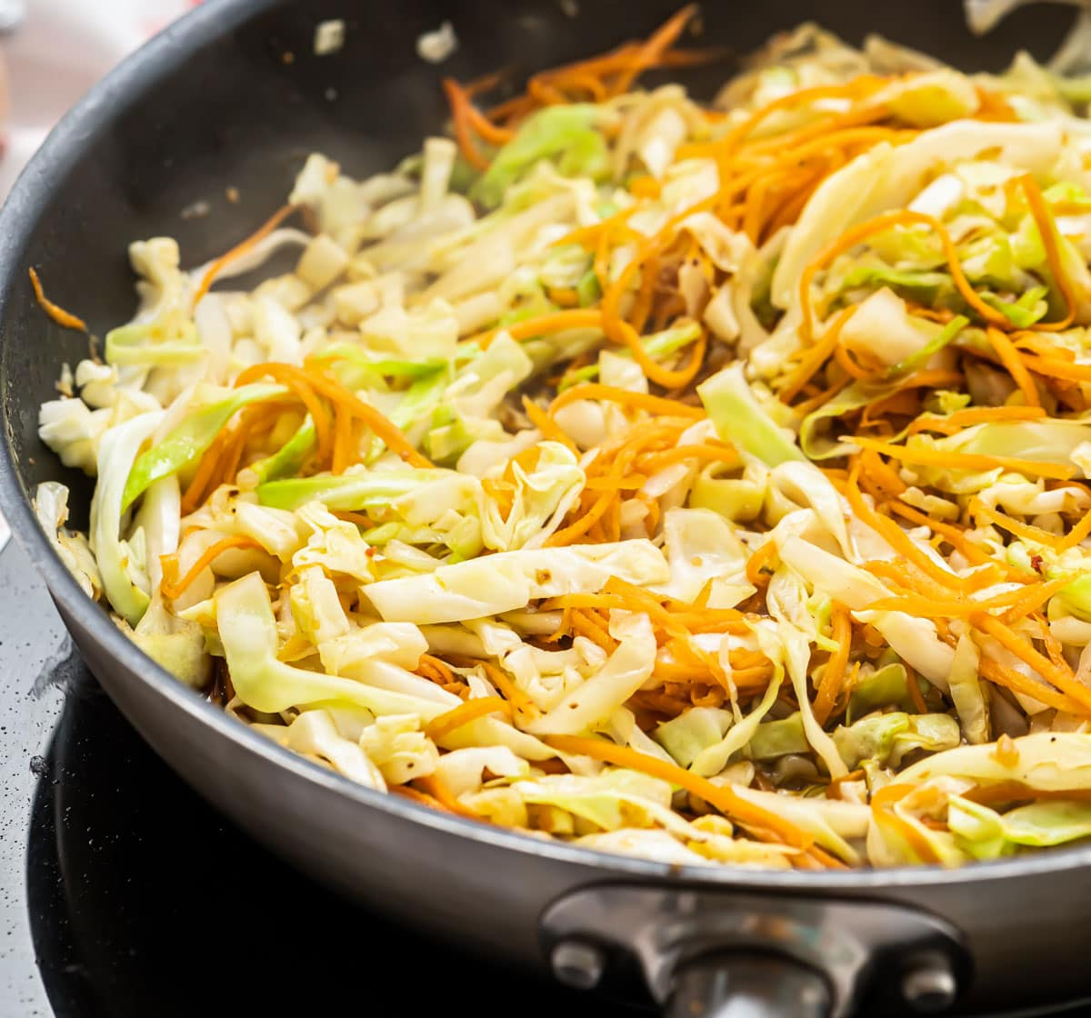 A skillet with cabbage and carrots