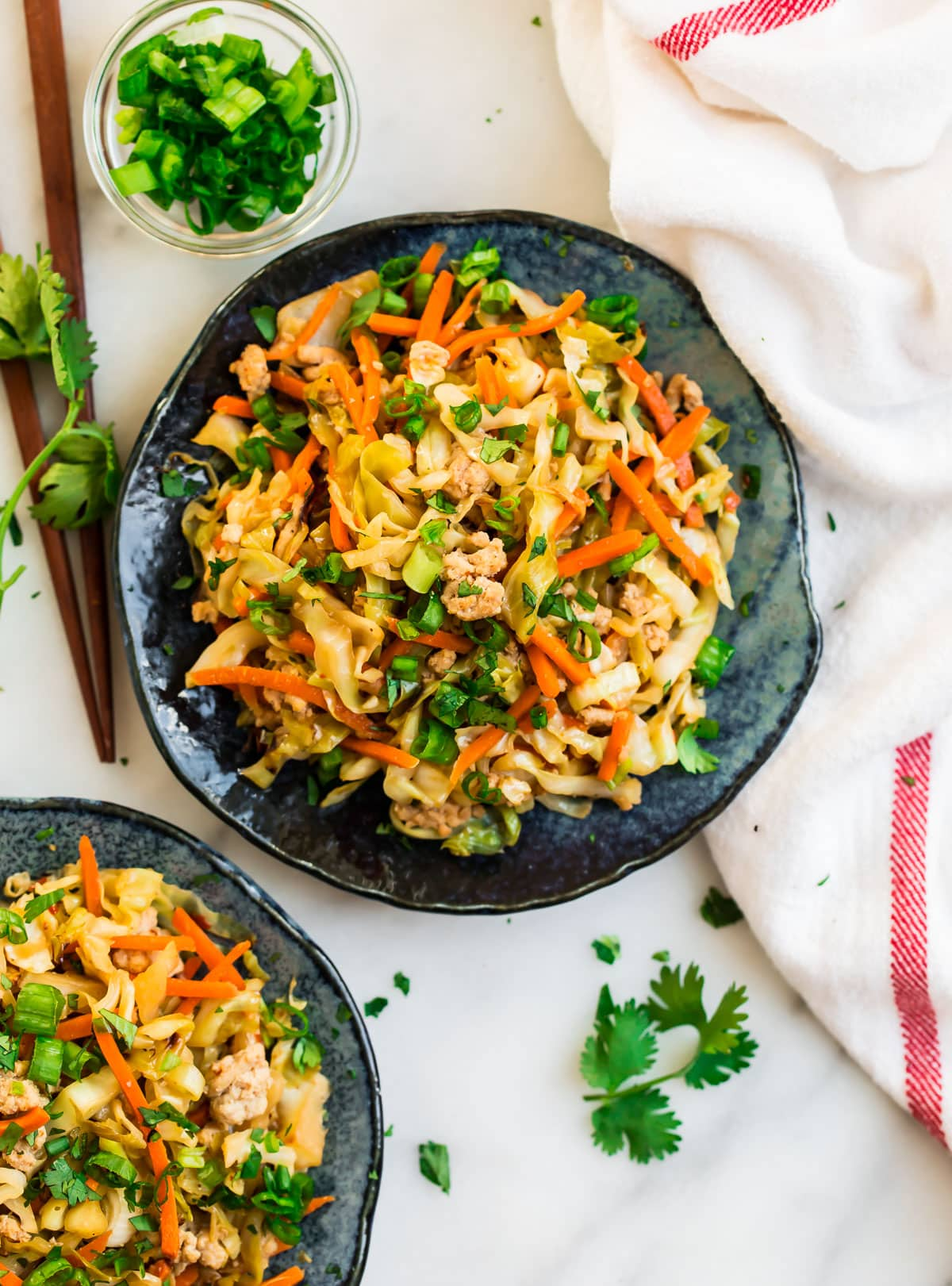 Cabbage stir fry on a plate with chicken