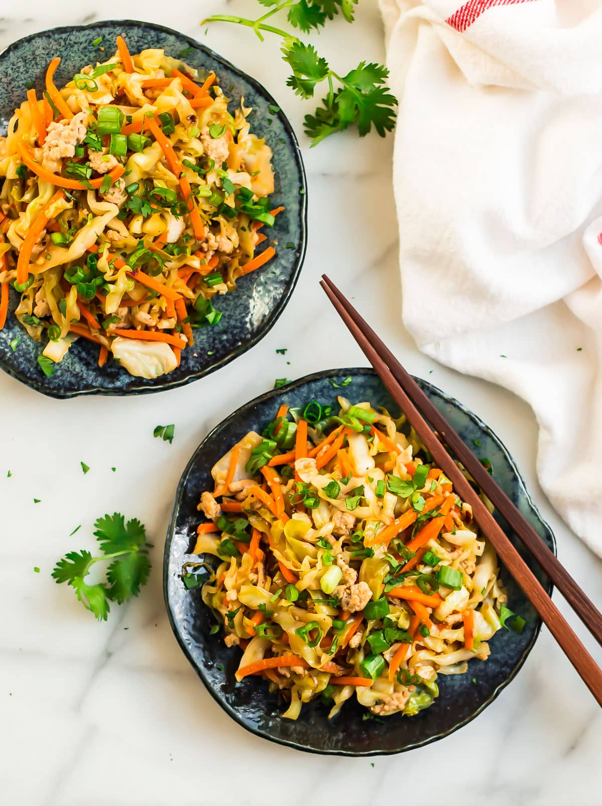 Two bowls of healthy cabbage stir fry