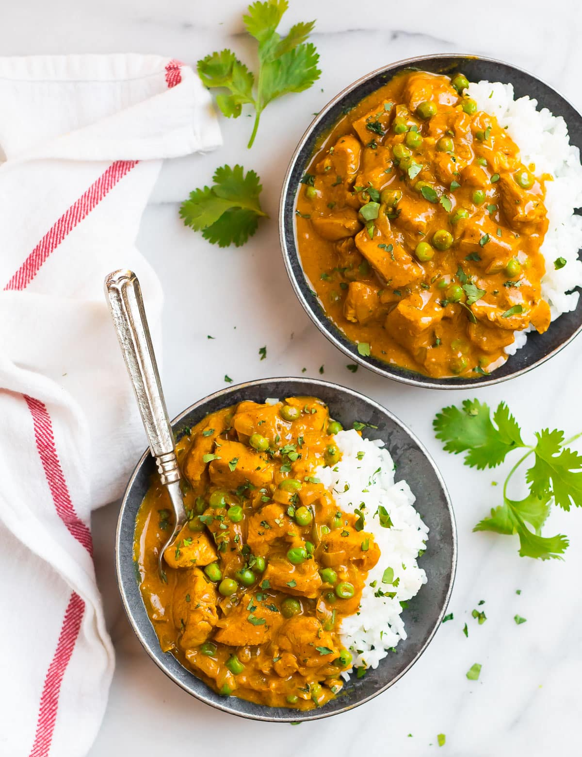 Healthy chicken tikka masala served in two bowls