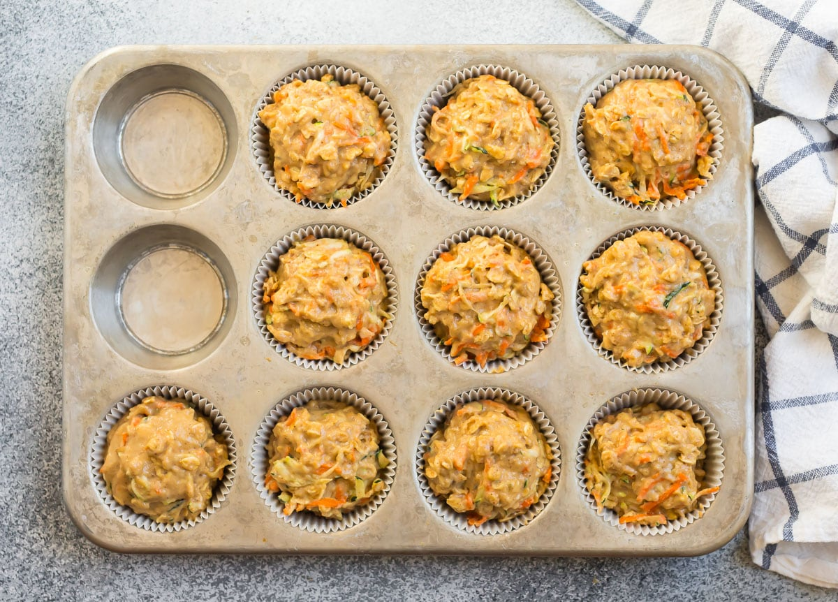 Healthy zucchini carrot muffins in a muffin pan