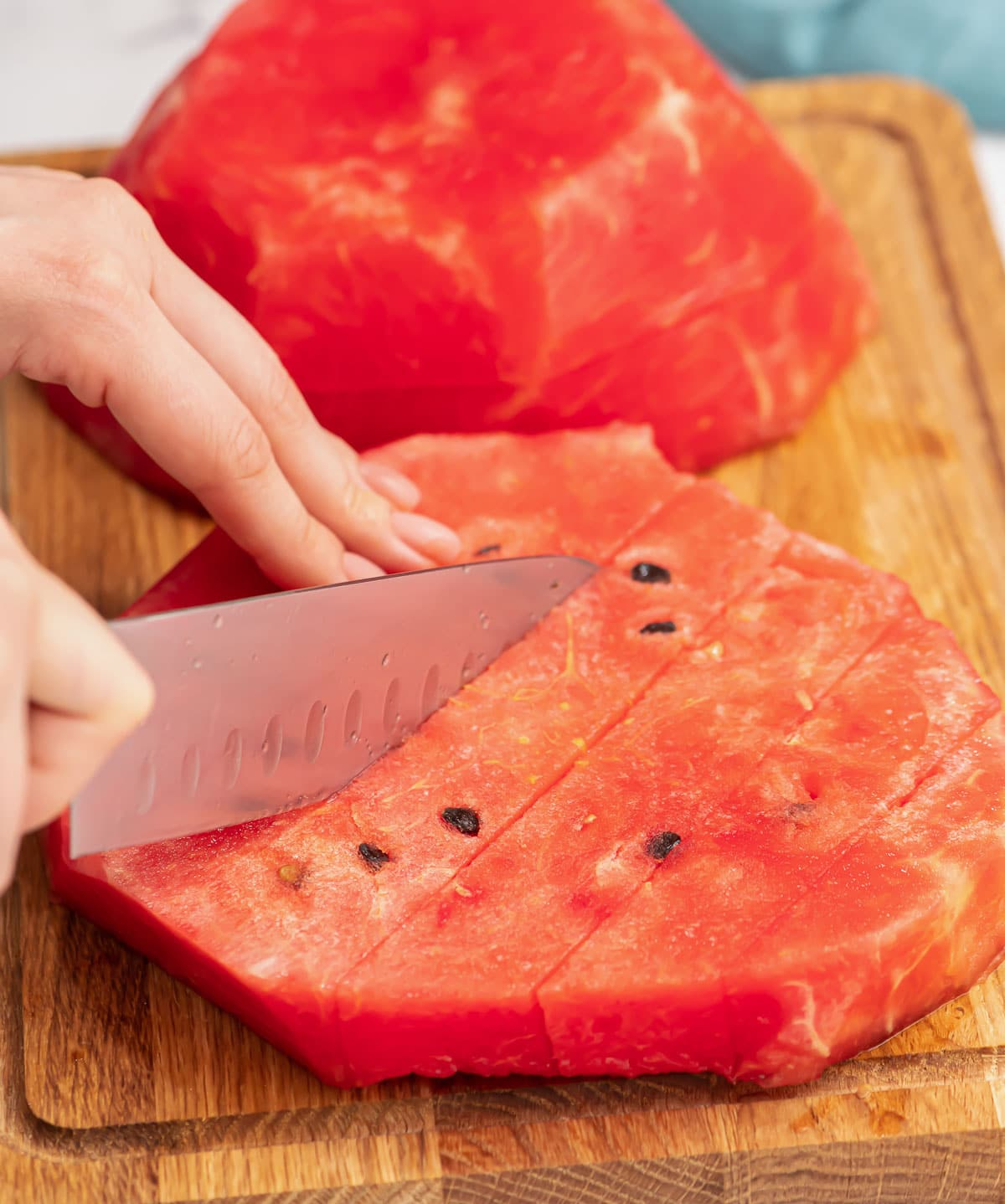 Watermelon being cut with a knife
