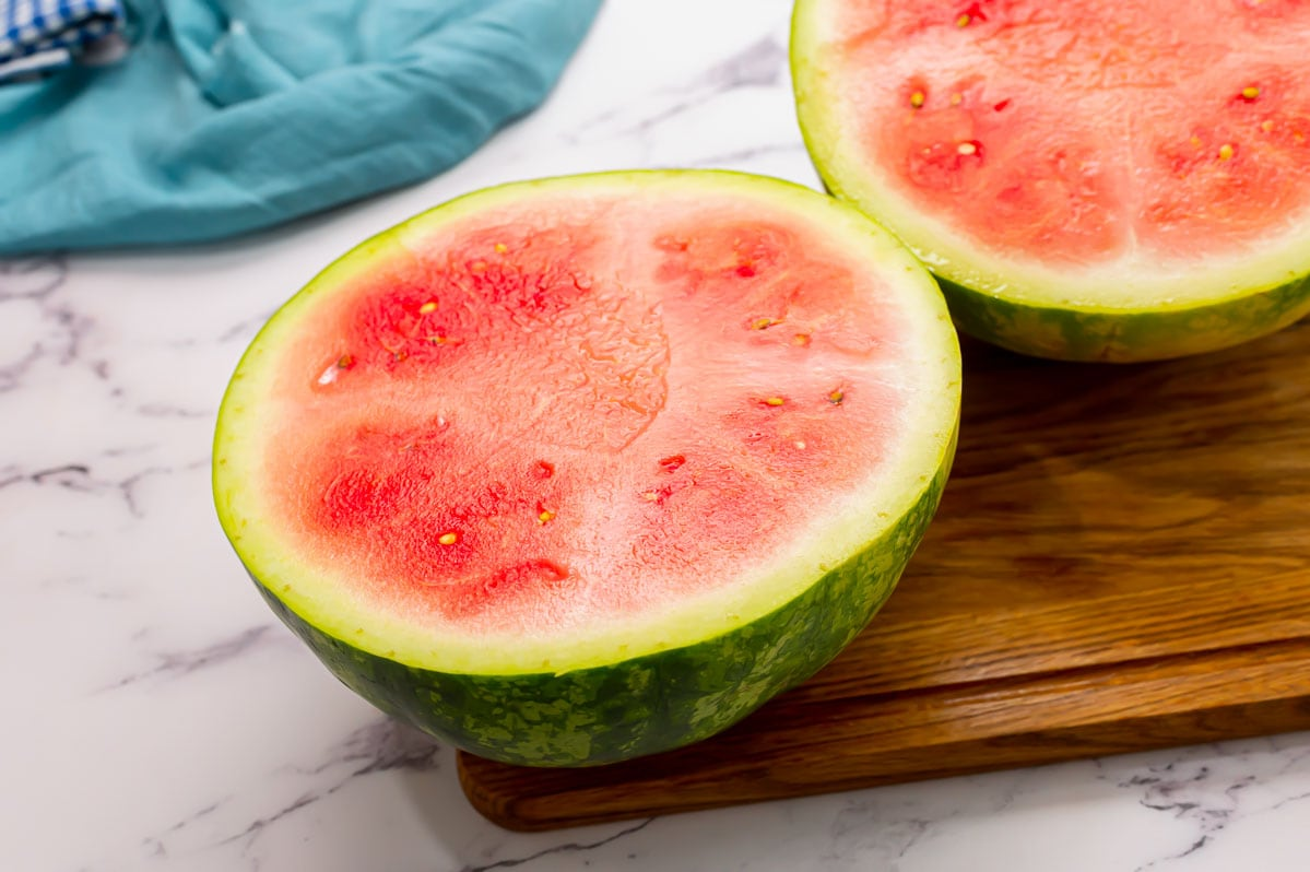 A fresh watermelon cut in half