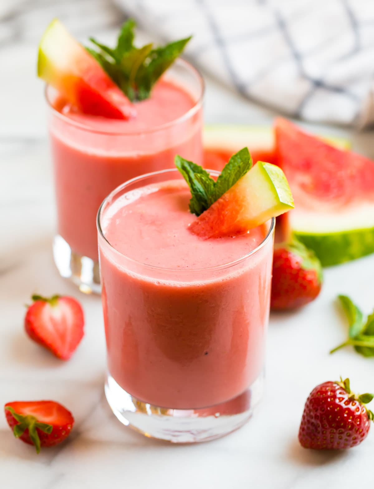 Two watermelon smoothies with strawberry