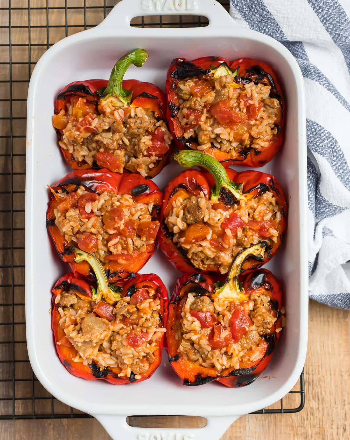Grilled stuffed peppers in a baking dish
