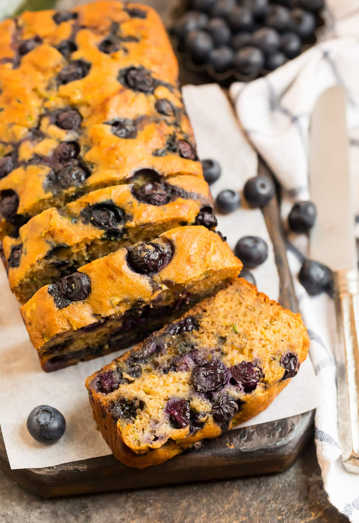 A loaf of zucchini blueberry bread cut into slices
