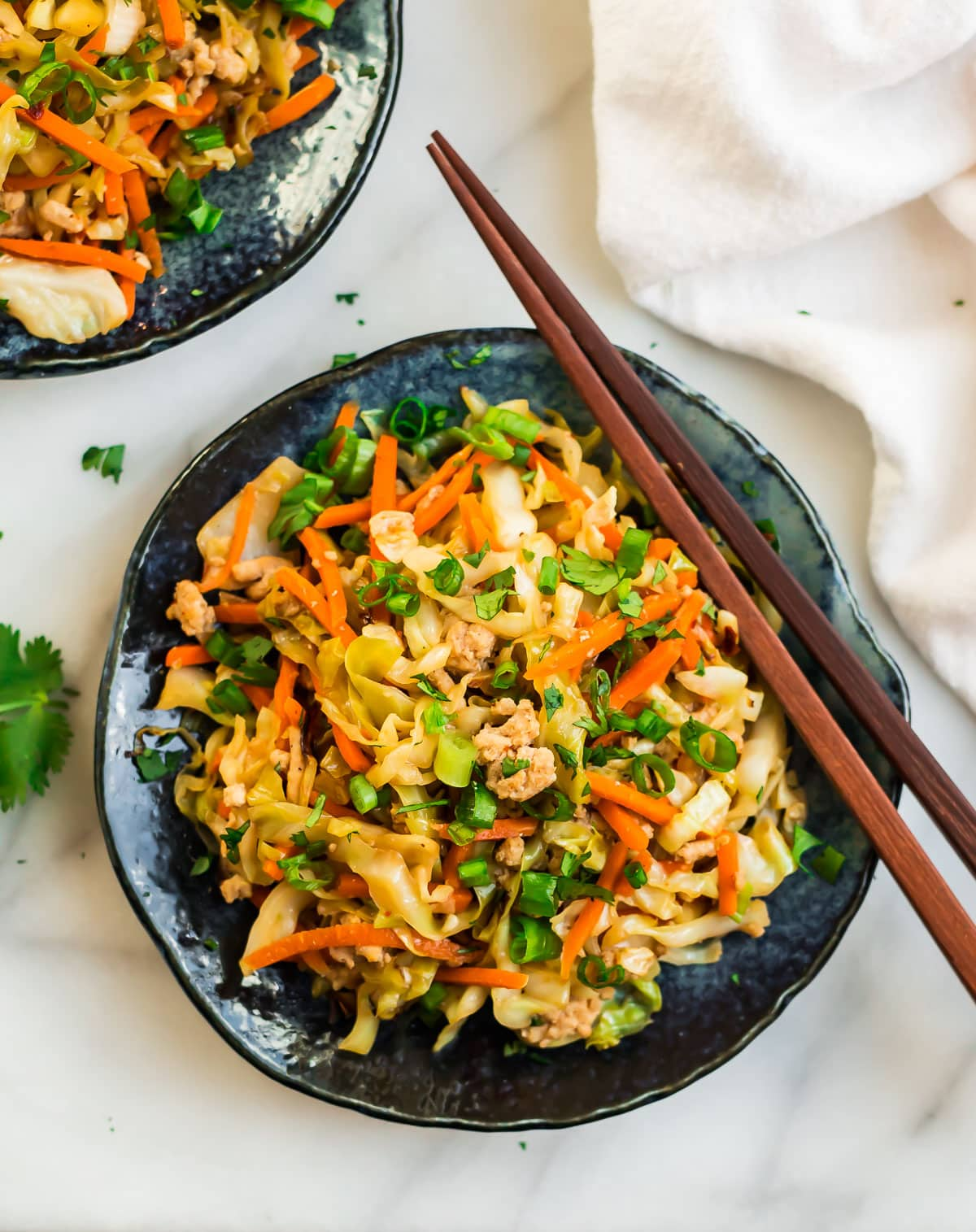 Chicken and cabbage stir fry on a plate