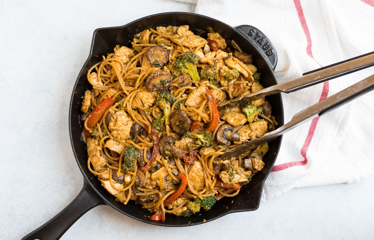 Noodle stir fry in a cast iron skillet