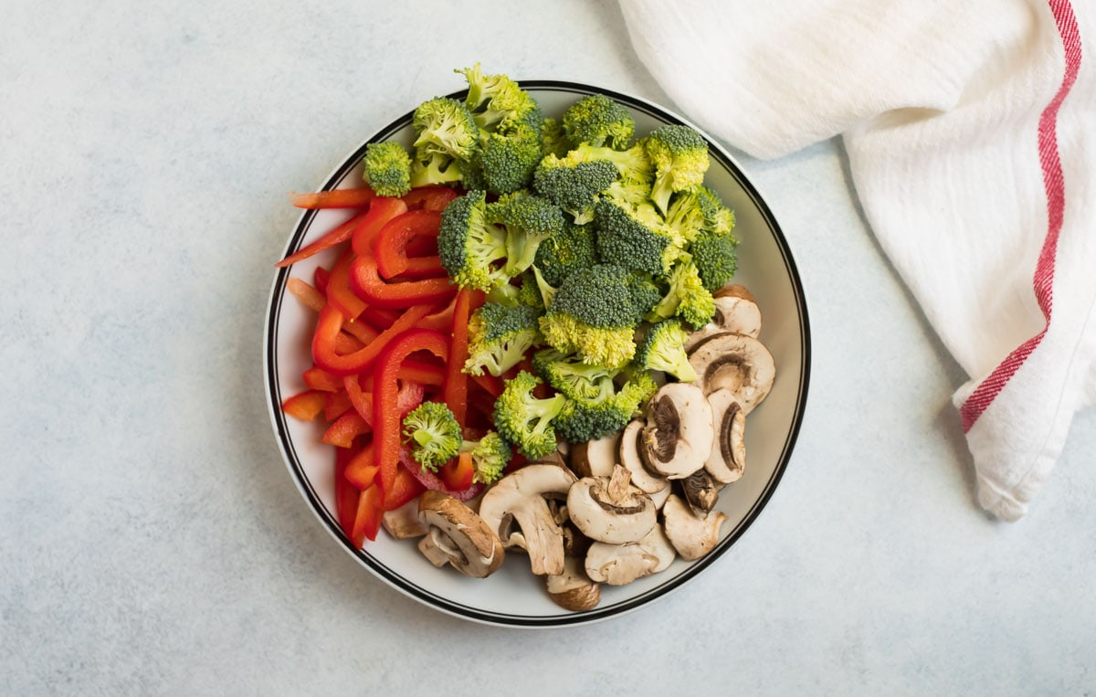 Red peppers, broccoli, and mushrooms in a bowl