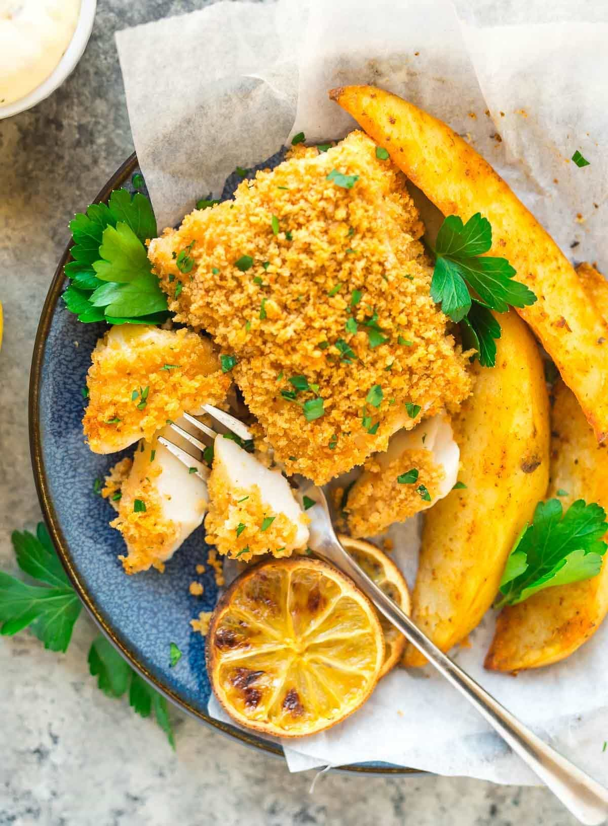 Baked fish and chips in a bowl
