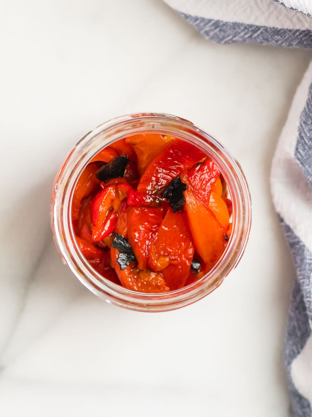 Healthy roasted red peppers in a jar