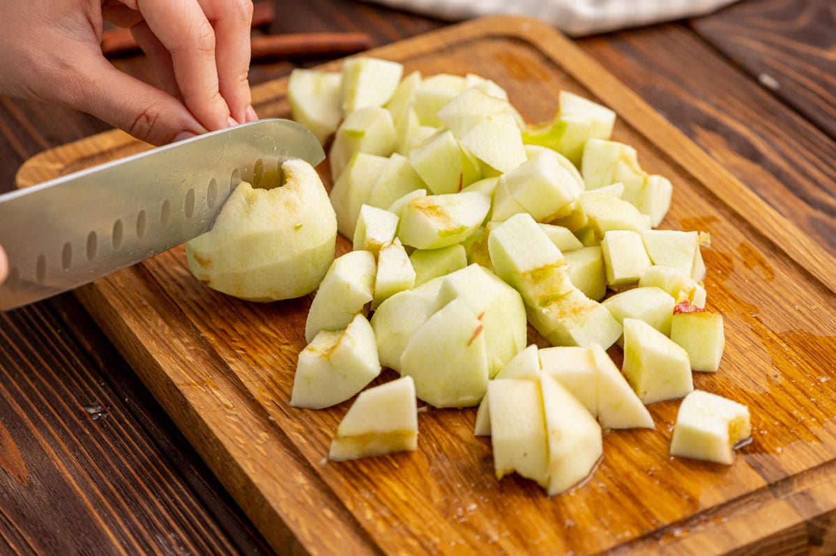 Apples being cut on a cutting board