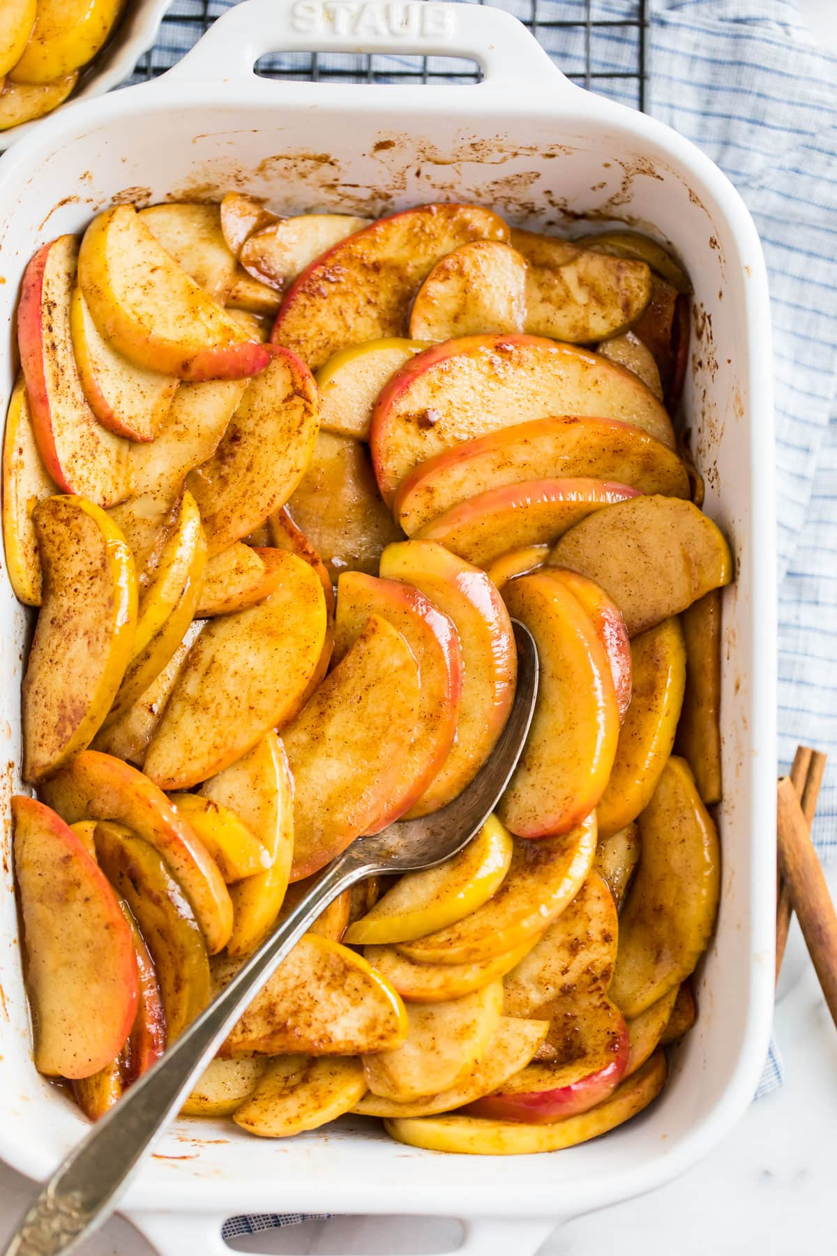 Cinnamon baked apples in a white baking dish