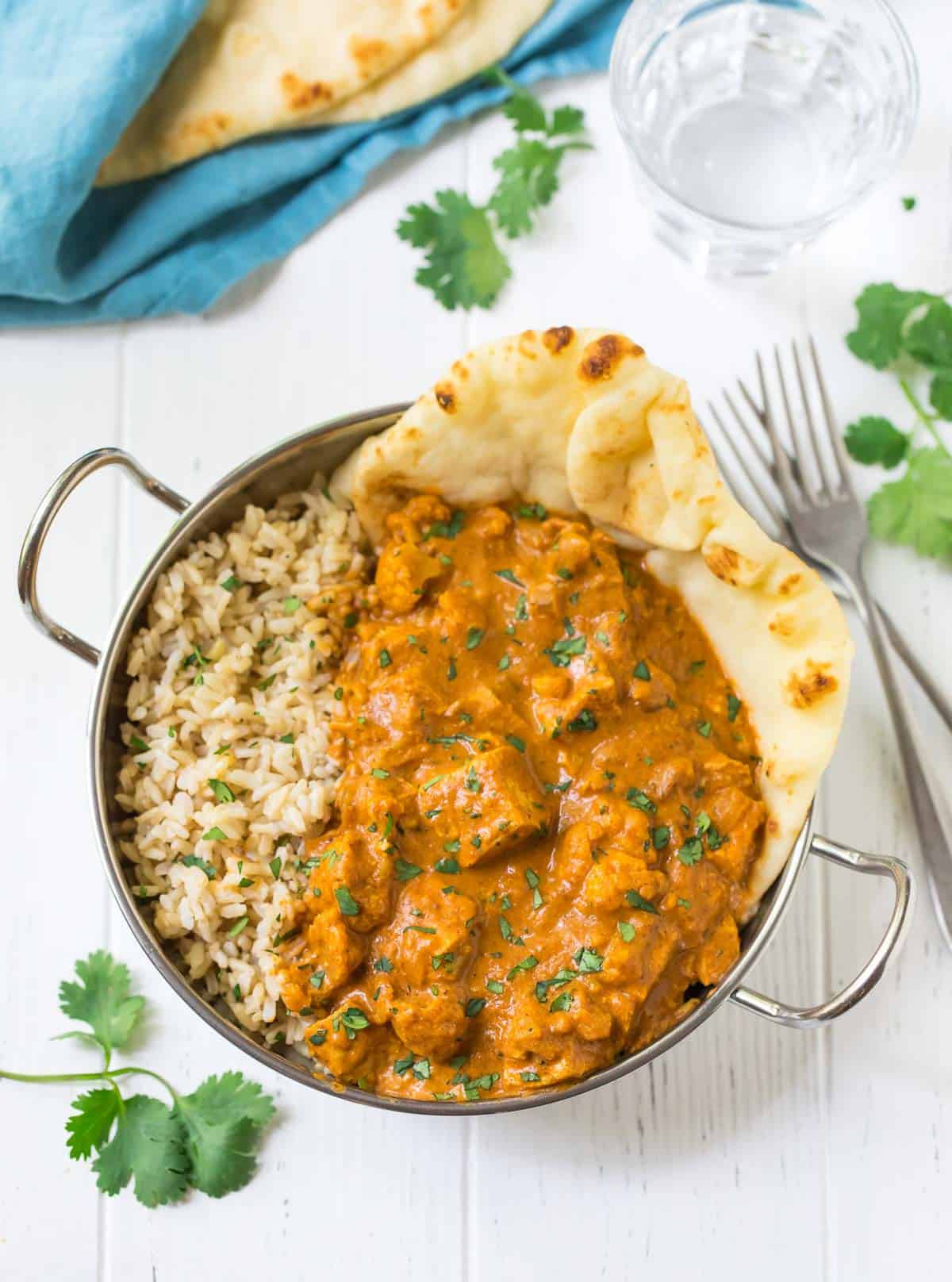 Instant Pot Butter Chicken. An easy, healthy recipe for the famous Indian butter chicken that anyone can make! Recipe uses easy to find ingredients like coconut milk and tomato, plus cauliflower to make it a true all-in-one meal.