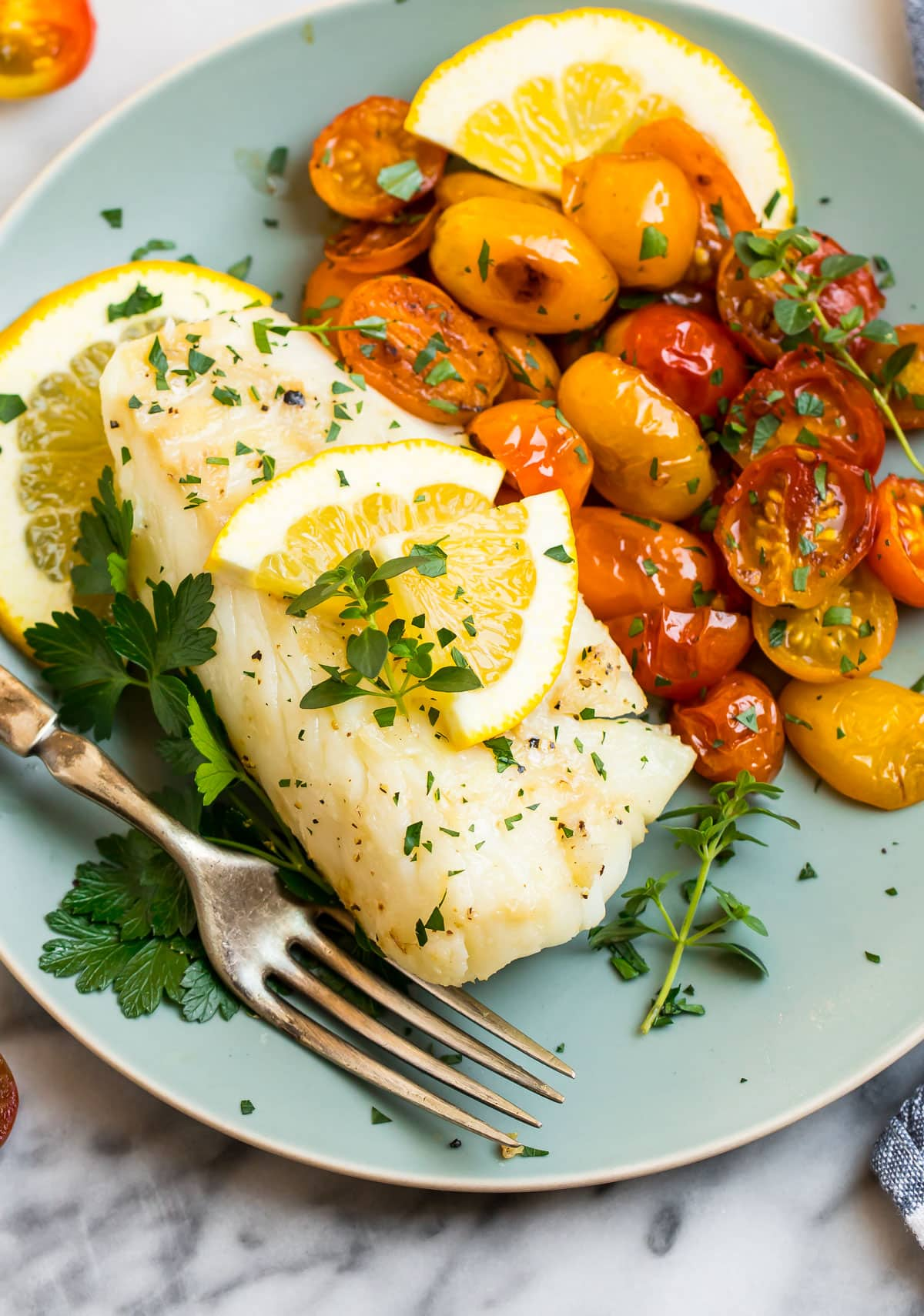 Pan fried cod with tomatoes