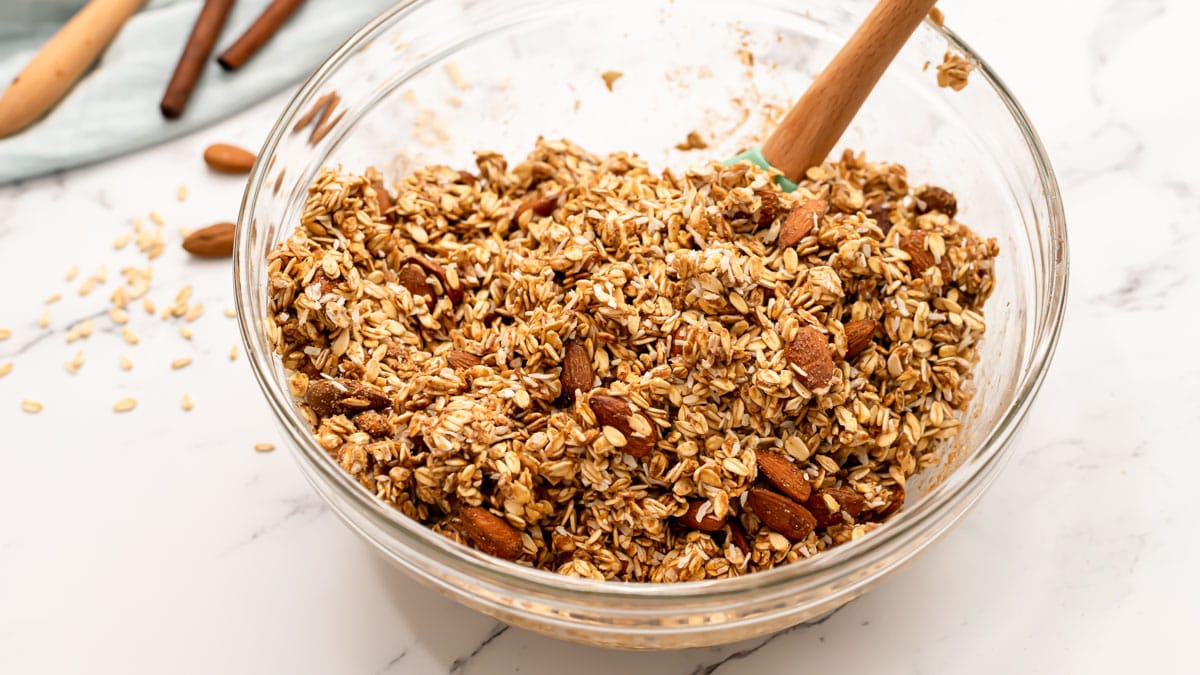 a bowl of oats and almonds for making healthy granola