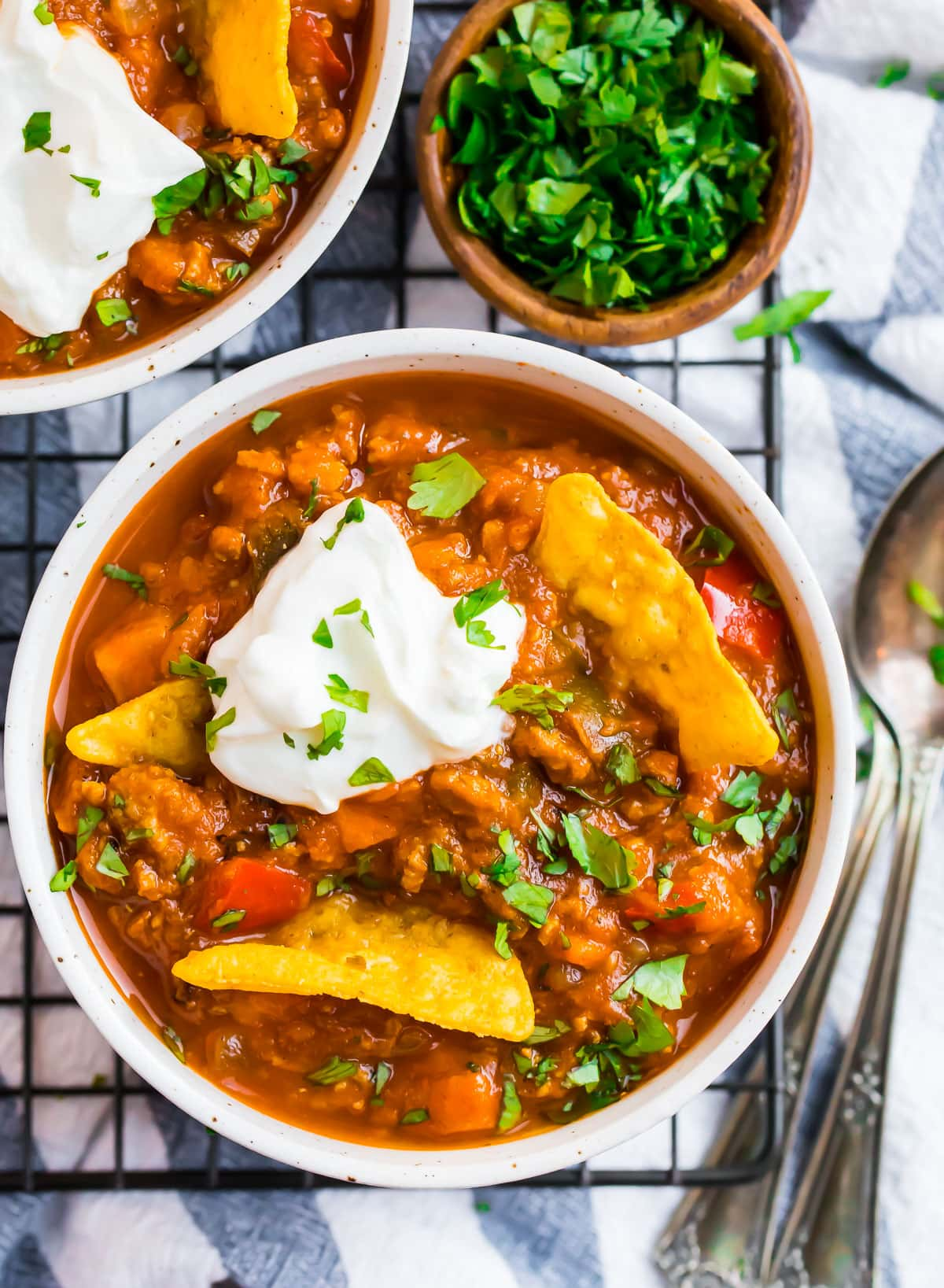 A bowl of turkey pumpkin chili with chips