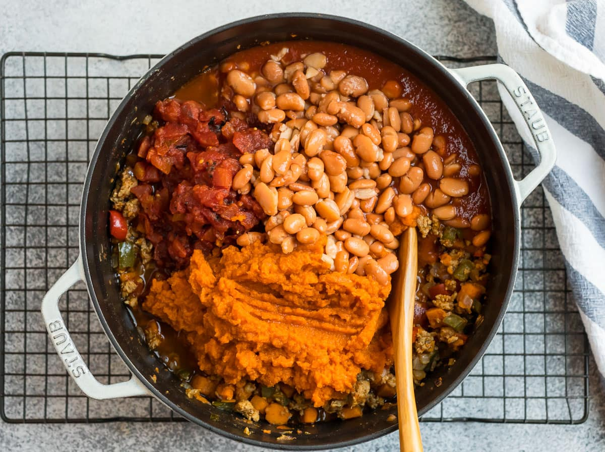 Beans, pumpkin, turkey, and veggies in a Dutch oven