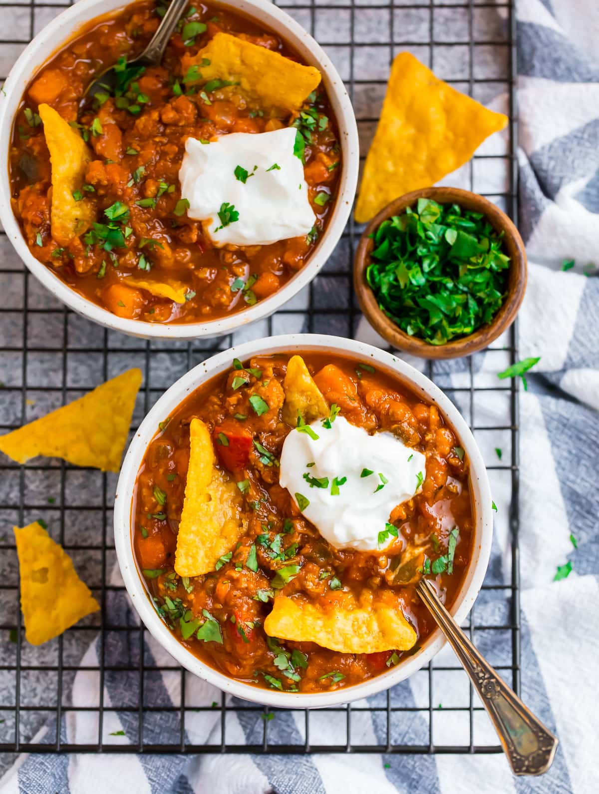 Two bowls of chili with turkey and pumpkin