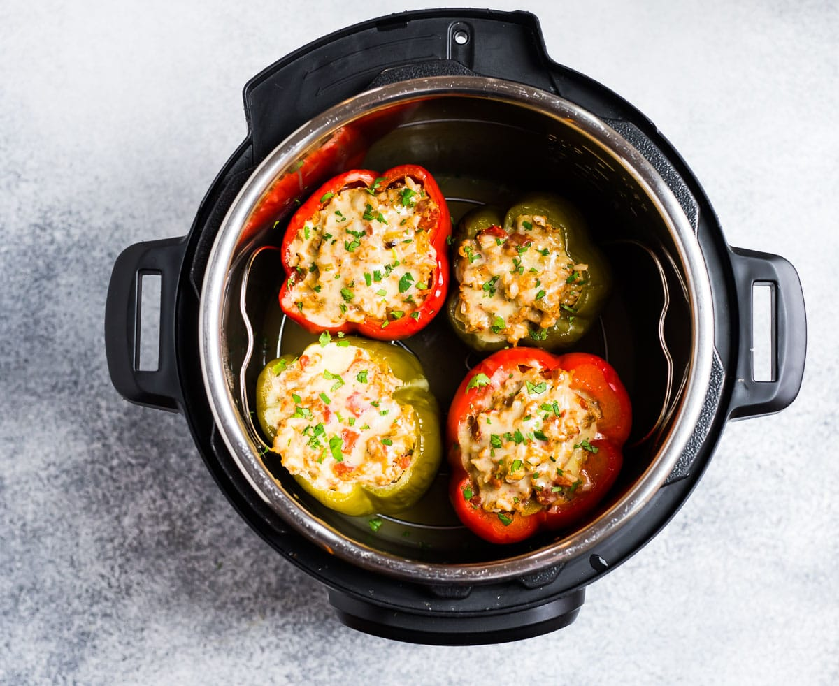 A pressure cooker with stuffed peppers
