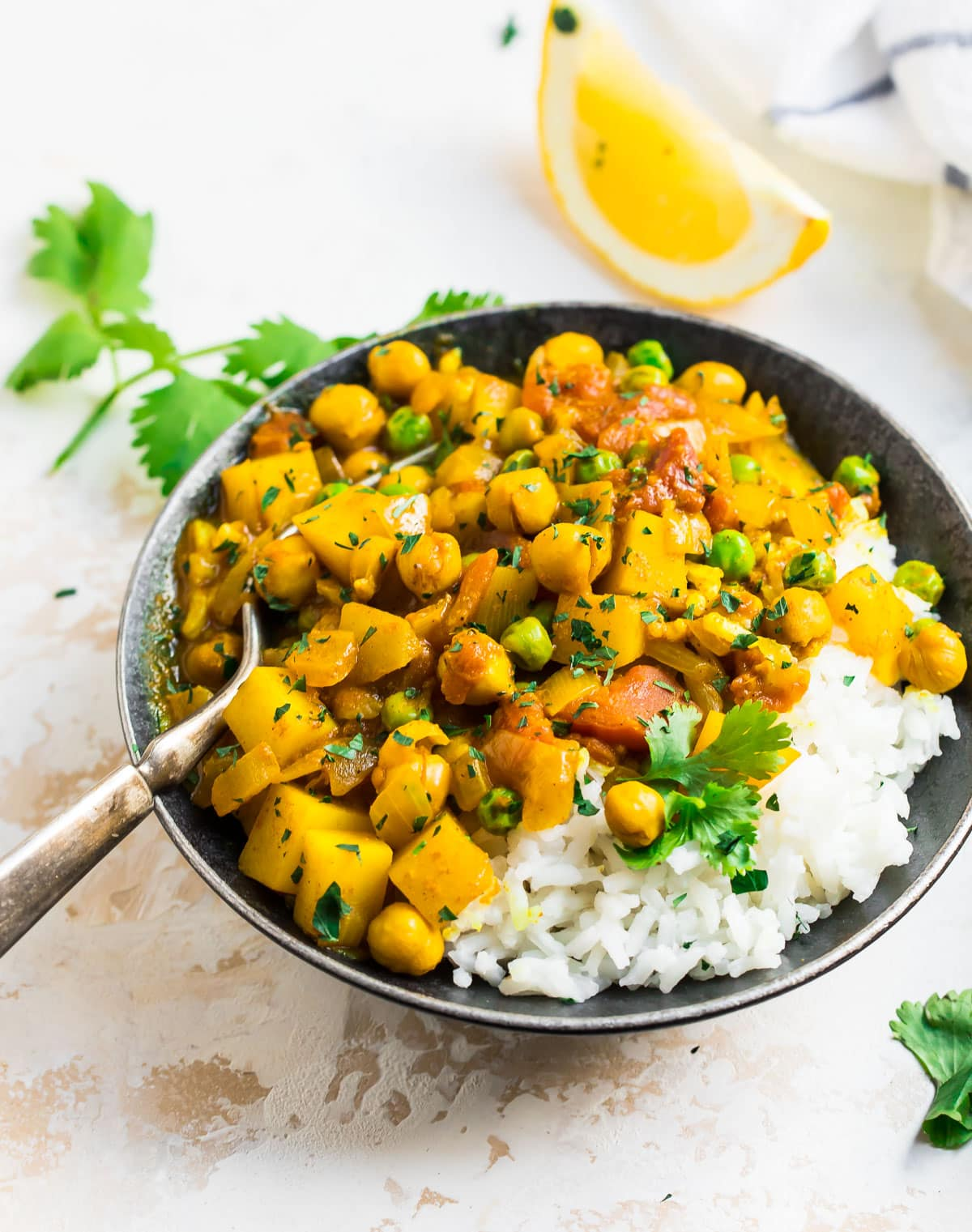 Potato curry with rice and chickpeas in a bowl