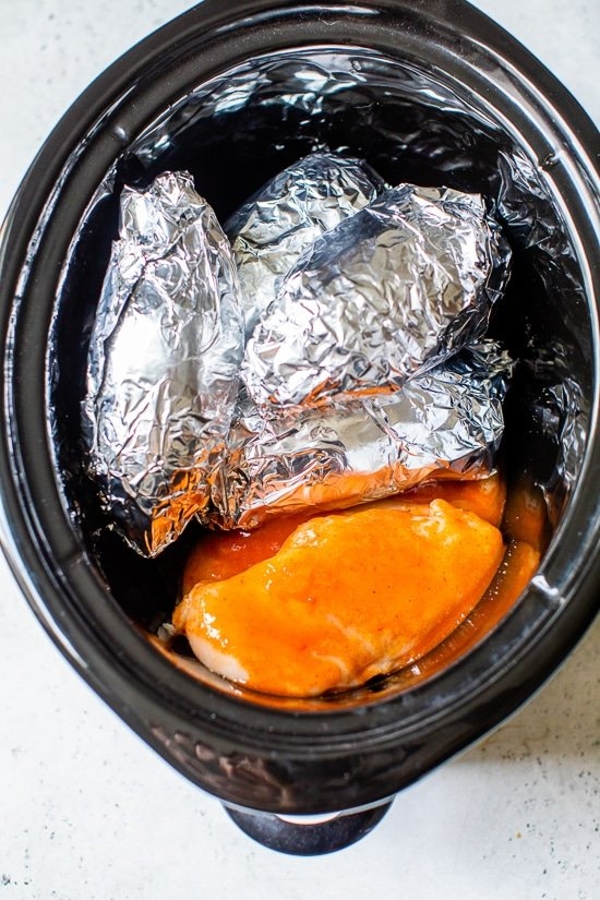 Slow cooker with sweet potatoes and chicken.