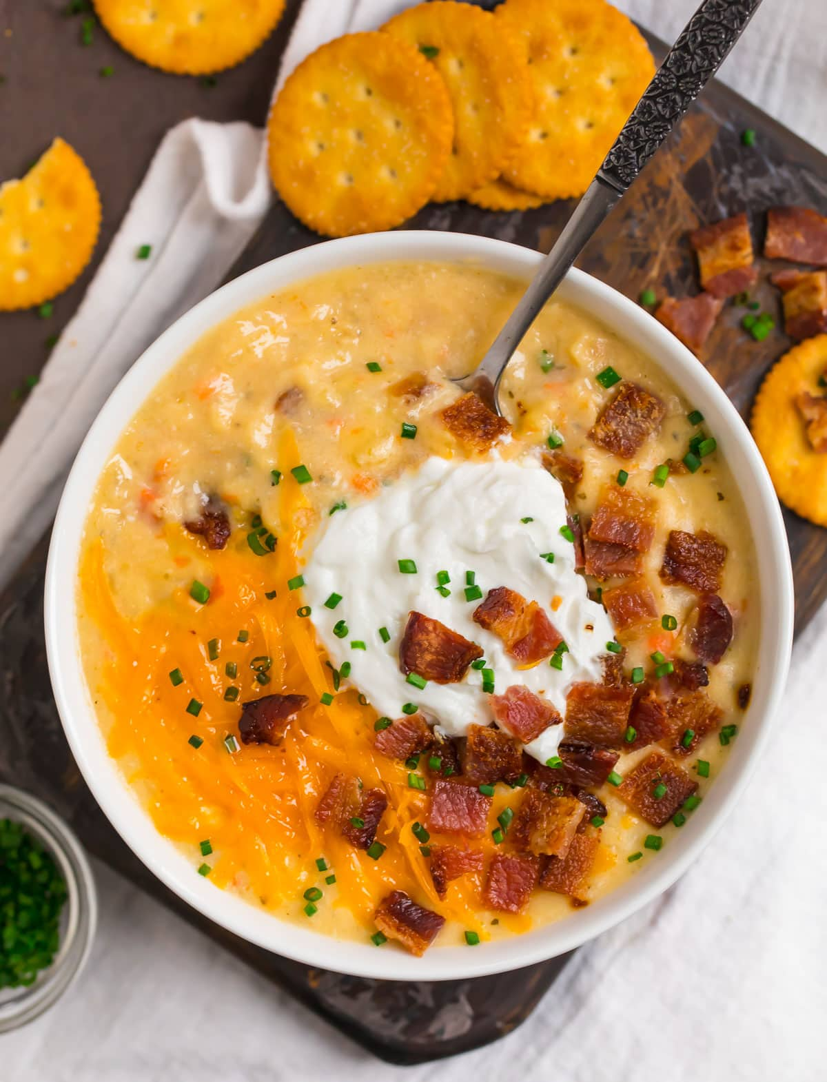 Bacon crockpot potato soup with cheese and crackers