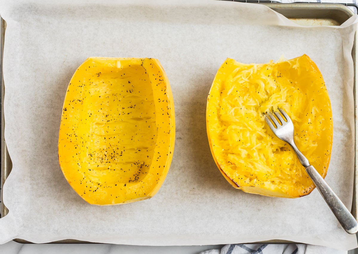 Two squash halves with seasonings