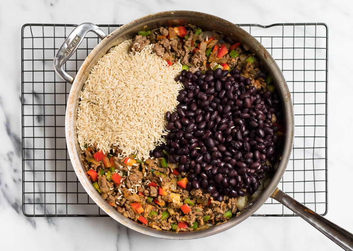 Ground beef and rice with vegetables and beans in a skillet