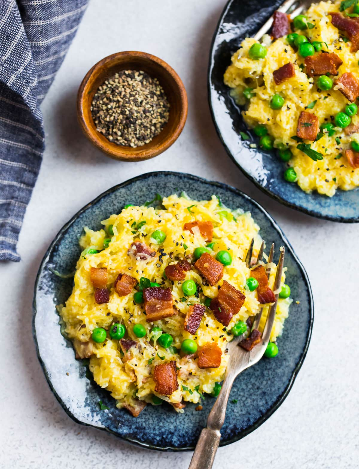Two plates of spaghetti squash carbonara
