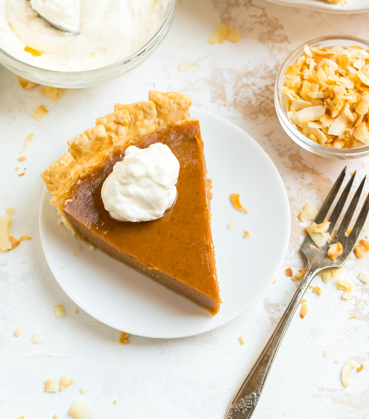 Old fashioned sweet potato pie recipe on a plate topped with whipped marshmallow cream
