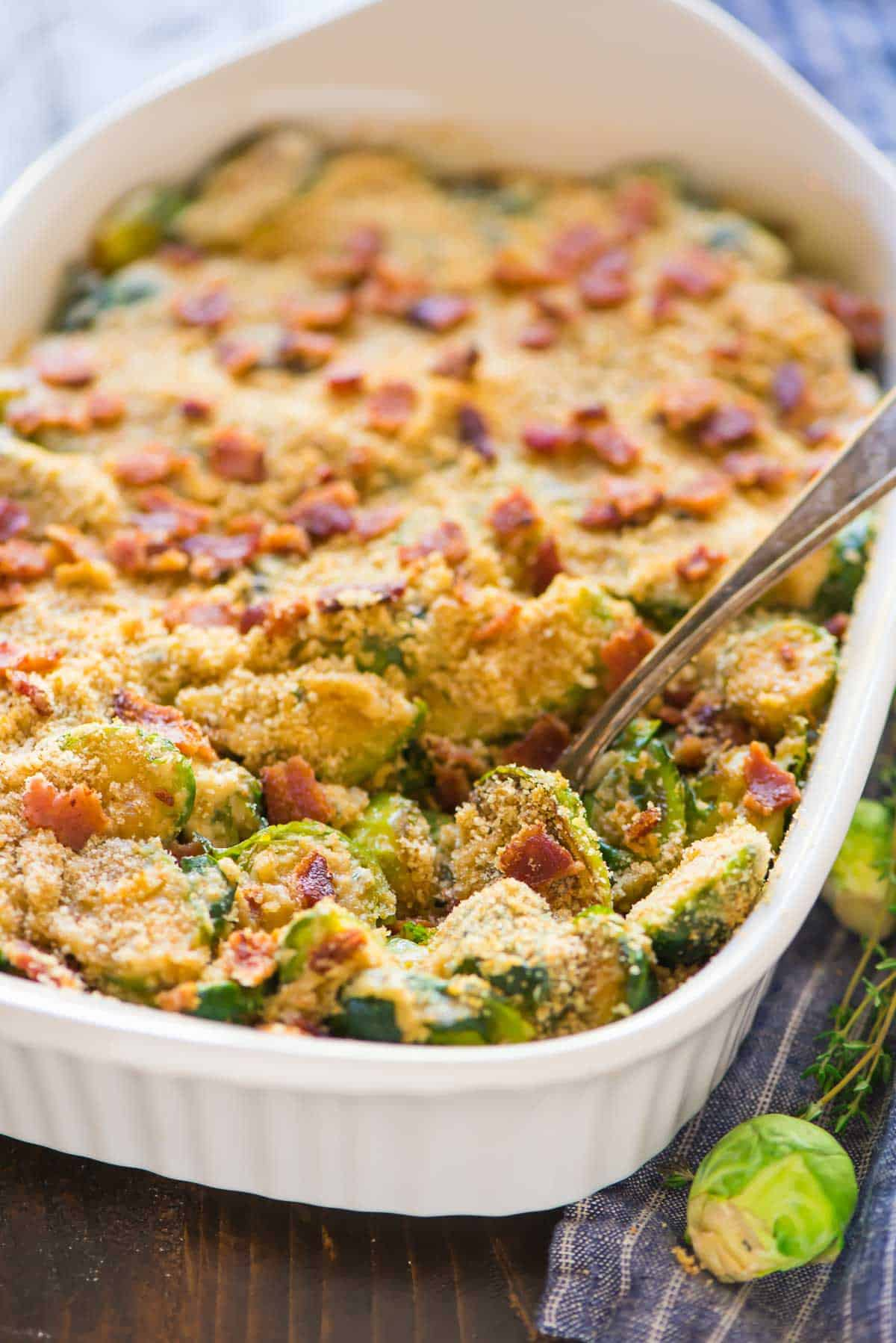 Bacon bits and breadcrumbs on top of a vegetable gratin