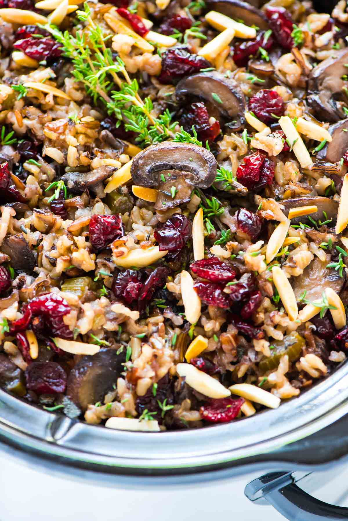 Mushrooms, cranberries, herbs, and almonds in a slow cooker