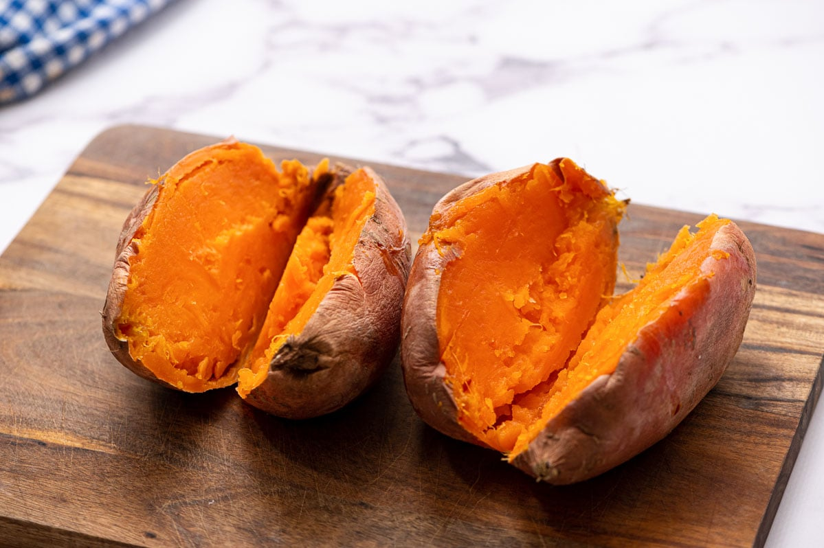 Two sweet potatoes cut open