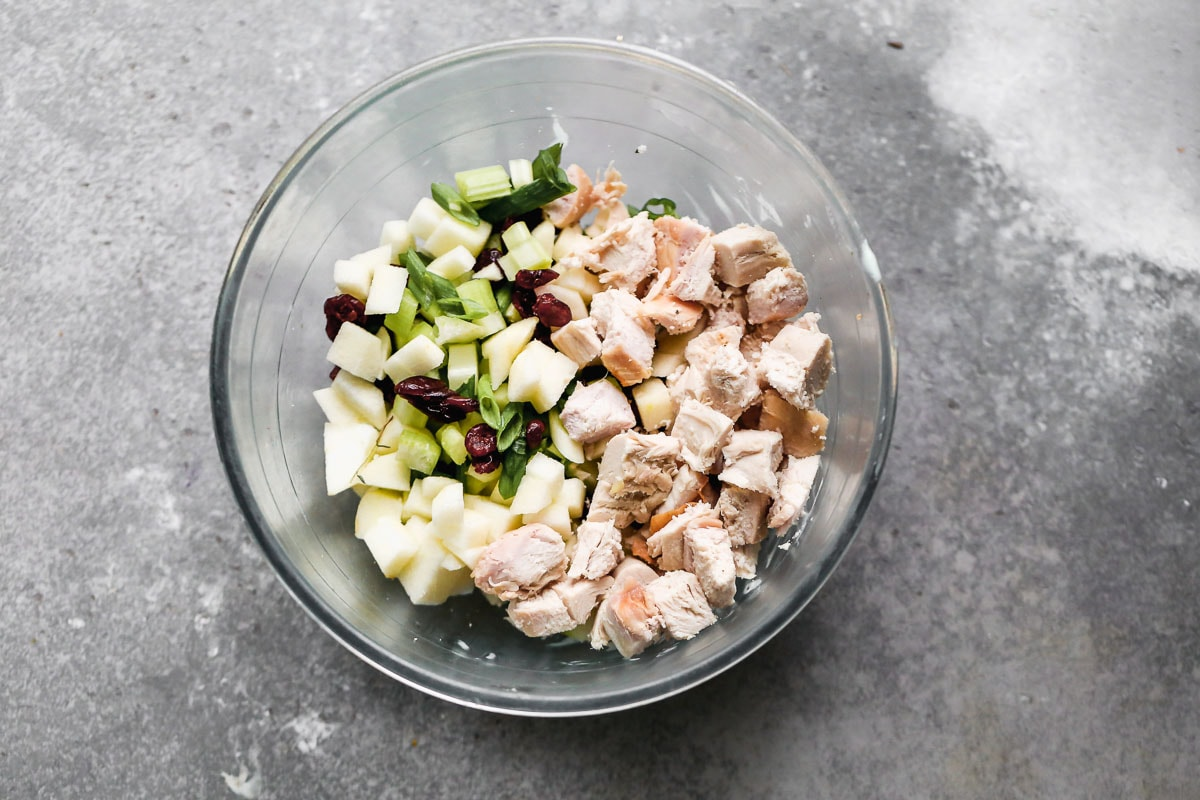 A mixing bowl with salad ingredients
