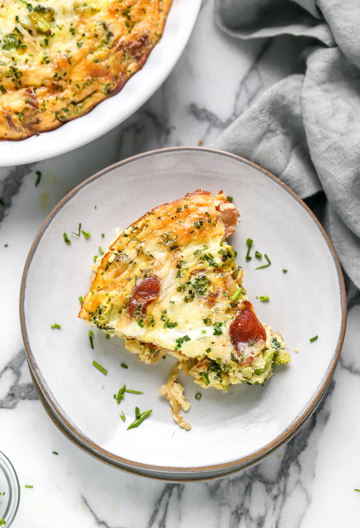 A piece of crustless quiche on a plate
