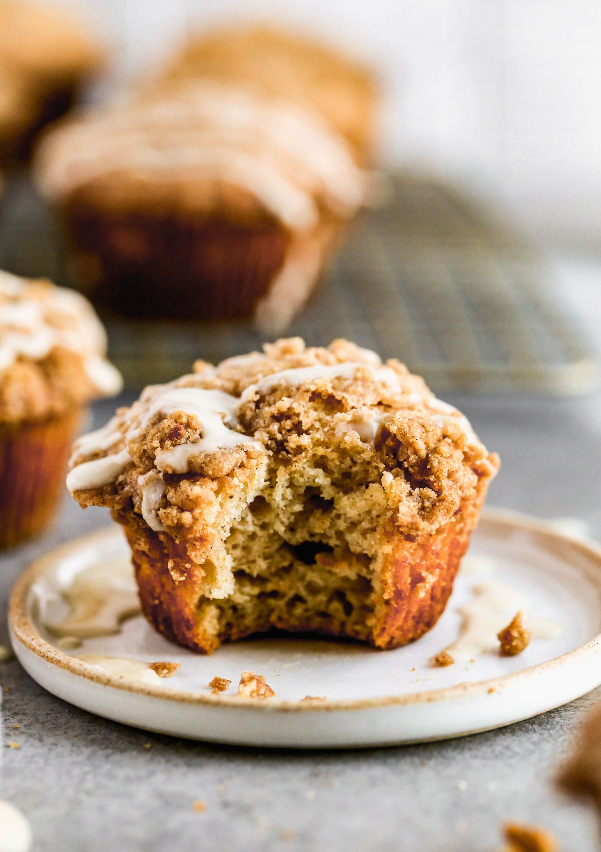 A coffee cake muffin with a bite missing