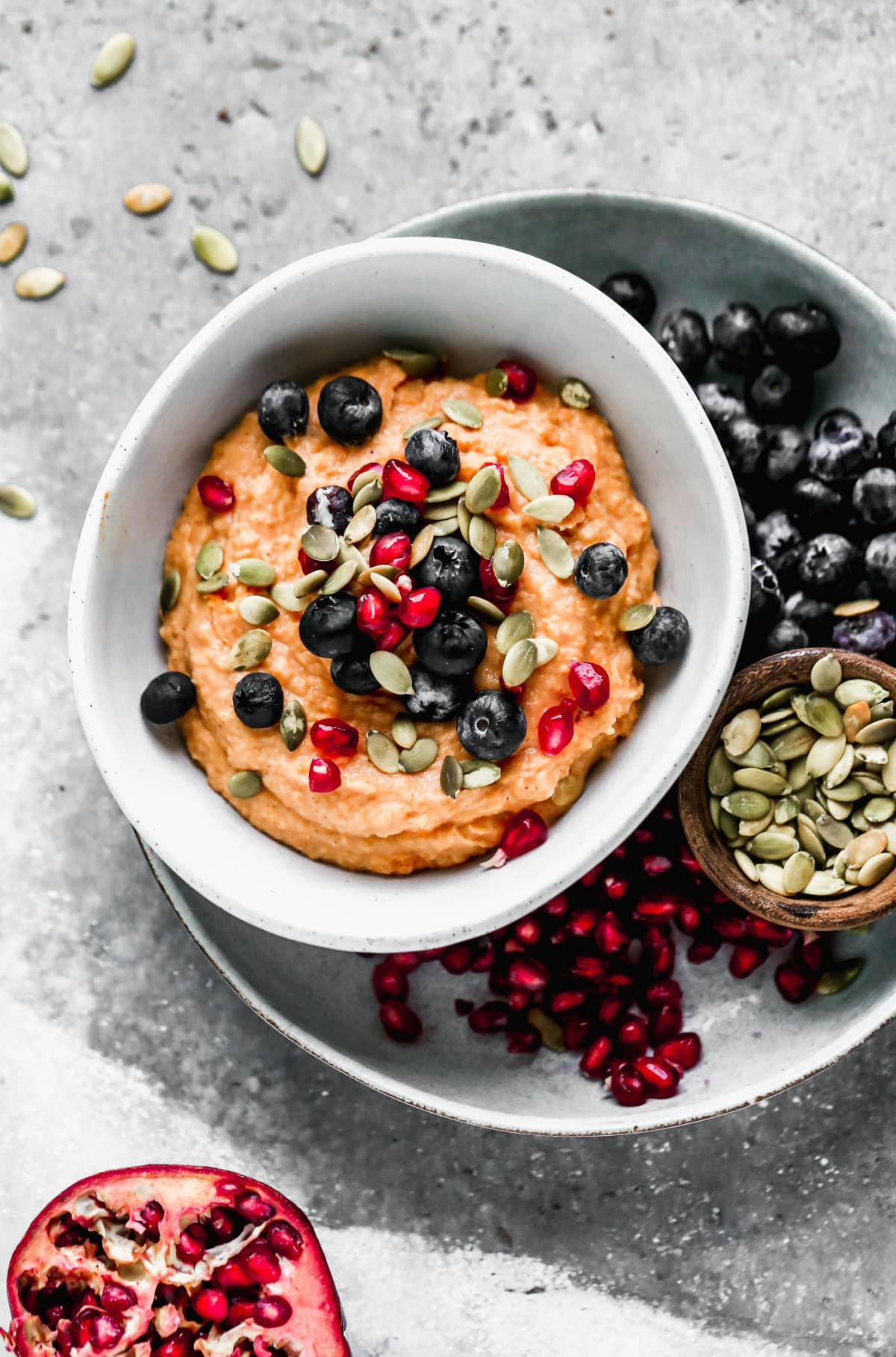 A Whole30 breakfast bowl topped with blueberries